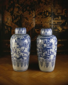 At Petworth House, two Chinese lidded vases, backed by a Chinese lacquer screen. ©National Trust Images/Christopher Hurst