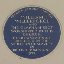 The blue plaque on the church, commemorating the 'Clapham Sect'.