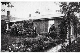 Miss Sarah Sprules in her garden. (Credit: Sutton Local Studies and Archives)