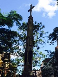 Basil Champneys' cross, in All Saints' Garden.