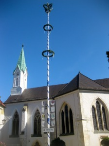 A cheerful maypole outside the church.