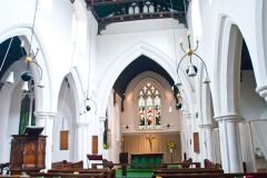 The interior of St Bene't's church.