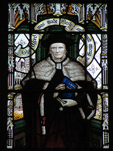 Brooke Foss Westcott, in the centre panel of the stained glass window in the north aisle of All Saints. He carries his edition of the Greek New Testament, and is flanked by George Herbert and