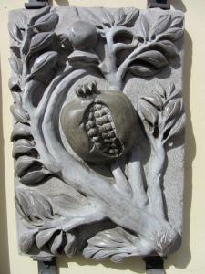 Carved pomegranate in Granada.