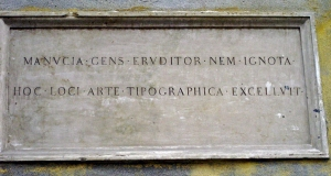Plaque on the Manutius family home in Venice. His workshop was destroyed in the 1960s, and replaced with a bank of such hideousness that I will not show it to you.