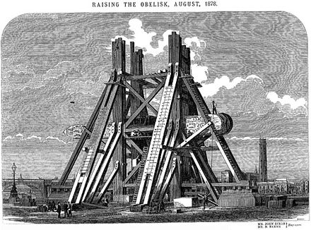 The raising of 'Cleopatra's Needle' in London, after its perilous sea voyage.