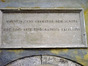 A largely overlooked memorial to Aldus Manutius on his former house.