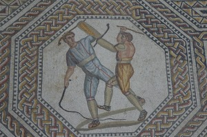 This remarkable mosaic from a Roman villa at Nennig near Trier, Germany, shows two combatants with shillelagh-like sticks in their left hands.