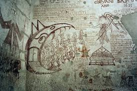 The walls of the Inquisition cells show graffiti by the prisoners: several are in English.