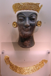 A burnt ivory figure and remains of gold decoration, from the Delphi Archaeological Museum.