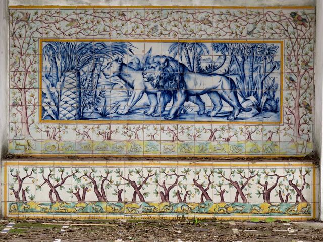 A lion and his mate take a stroll, in a polychrome scene at the entrance to the monastery.
