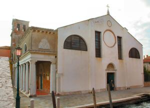 The symmetrical facade of Sant' Eufemia, with the odd addition of the portico.