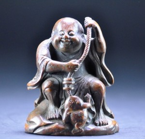 Bamboo carving of Liu Hai, with his cash-baited fishing line. (Qing Dynasty, 18th–19th century.)