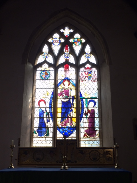 The east window: Lady Margaret's arms are above St Mary, and Bushop Fisher's (with cardinal's hat) above St Helena.