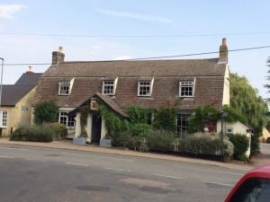 The Willow Tree pub in Bourn, opposite the road up to the Hall, the church and the former vicarage.