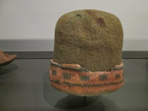 A turned-up, patterned brim: the pinkish colour may originally have been cream or white.