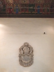 The memorial's height on the wall can be gauged from its distance from the ceiling, painted to a William Morris design in the nineteenth century.