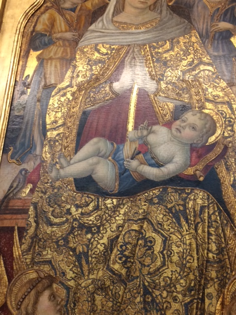 Another chunky yet flat baby, by Vittore Crivelli (late 15th century) in the Fitzwilliam Museum. Natty trousers, though, and he is holding a pink!