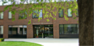 The new Faculty building, with welcoming cast in the doorway.