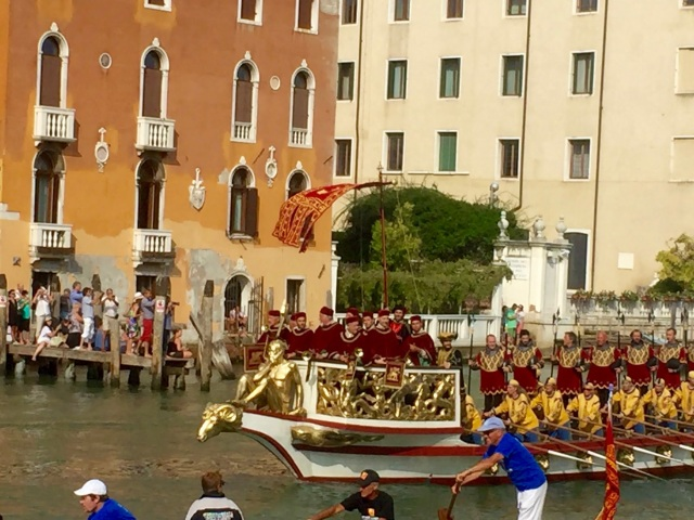 Trumpeters in the prow of a boat in the procession.