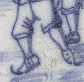 Delftware tile with a skating scene