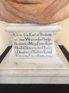 The caption on the plinth.