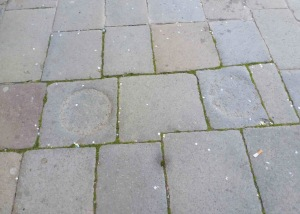 The indentations where the mortars stood. The cigarette butts are modern.