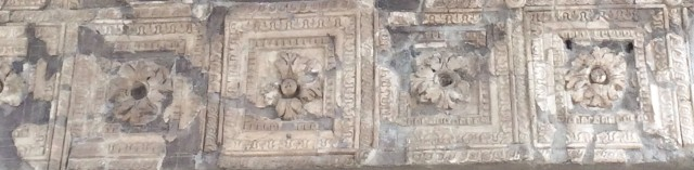 Section of a vaulted ceiling at Herculaneum, the many-petalled flowers in square frames resembling those of the portico of the Fitzwilliam Museum, Cambridge (below).