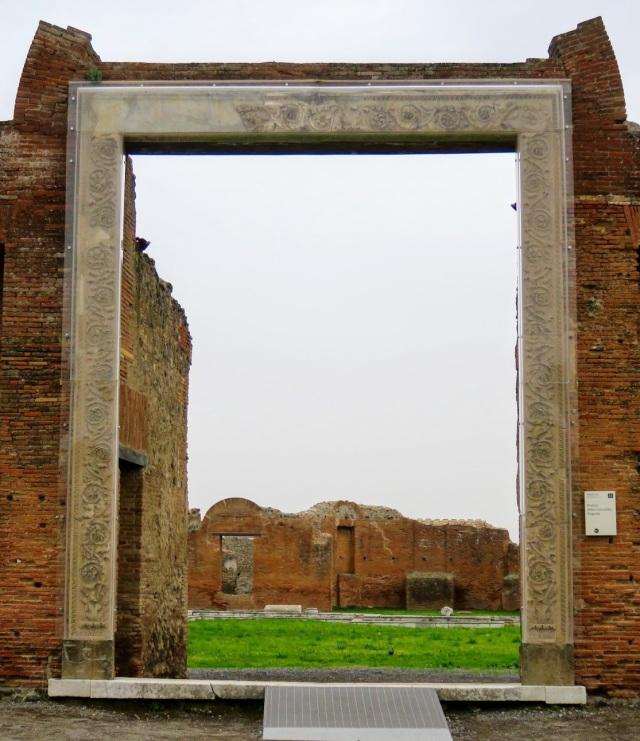 The gateway of Eumachia's building, now encased on perspex.